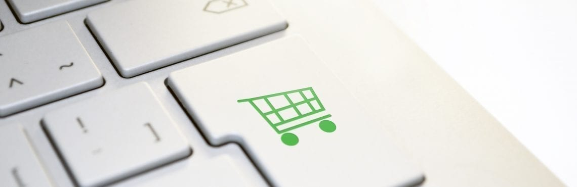 A keyboards button with a green shopping cart